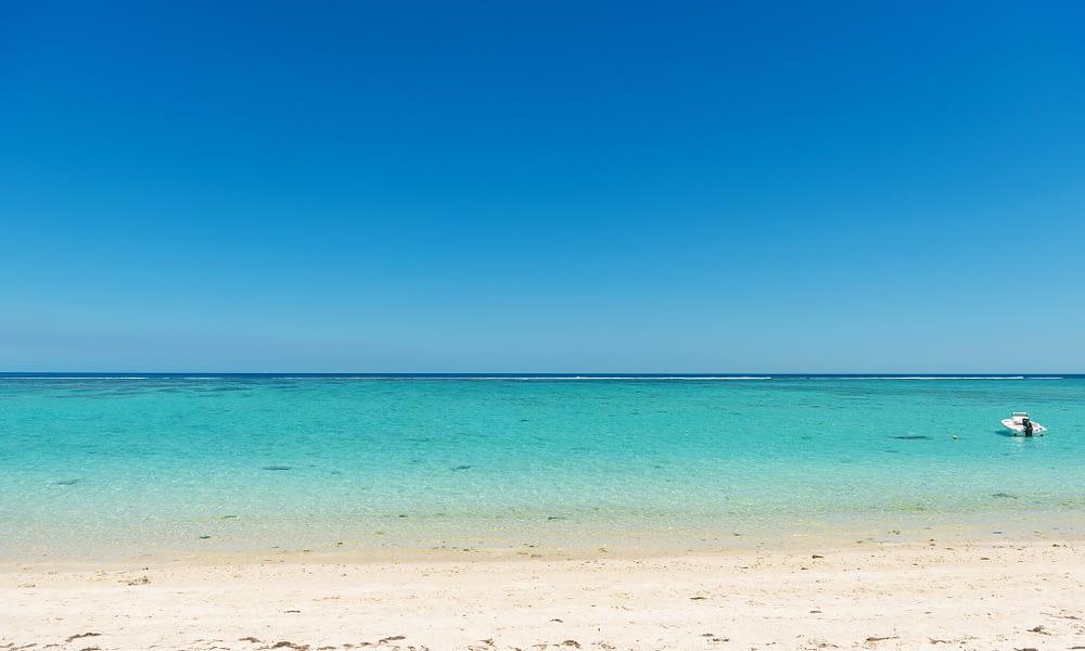 Cap Ouest beach blue sea