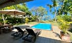 Villa Tropic 2 pool deck with sun beds