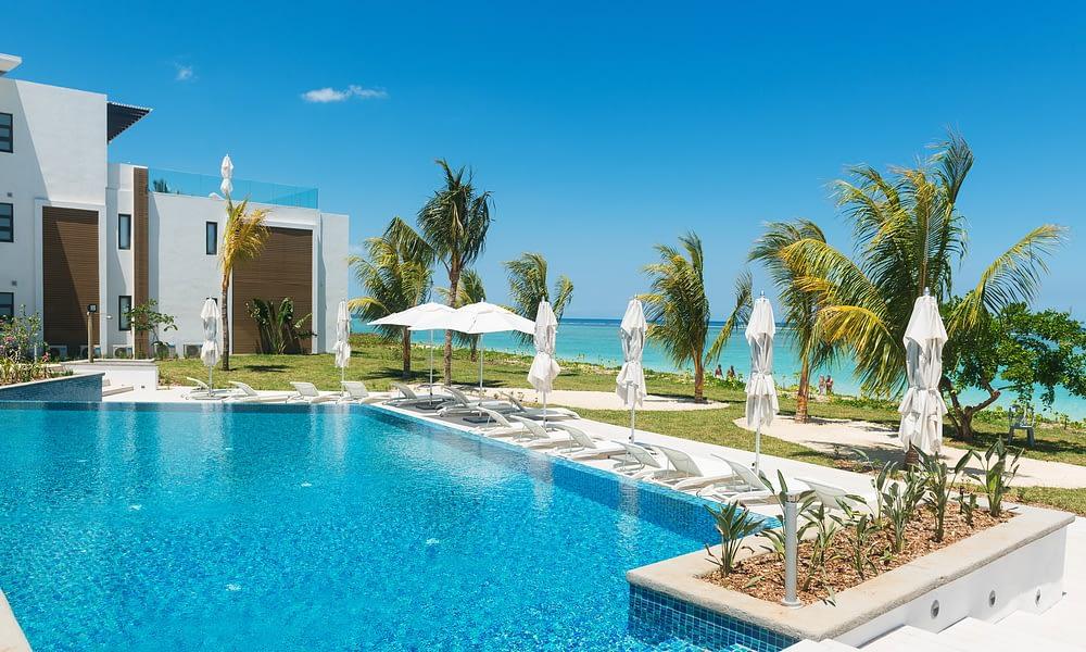 Cap Ouest beach pool sun garden
