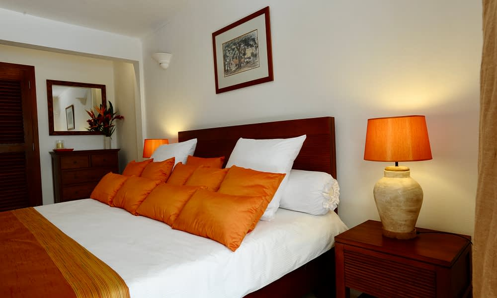 Villa Tropic 2 bedroom bed with decorative cushions